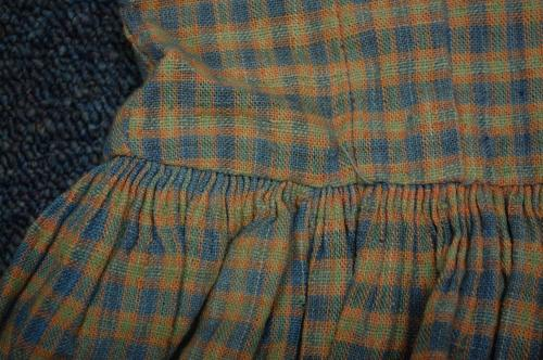 Plaid dress, waist detail. Piedmont NC. Collections of North Carolina State Historic Sites.  Accession number 2013.4.1