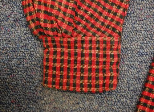 Cuff detail, woven Red and Black Plaid Dress, collections of North Carolina State Historic Sites, Accession Number S.HS.2013.4.2