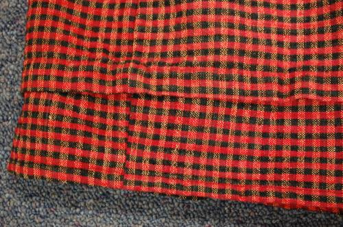 Hem detail, woven Red and Black Plaid Dress, collections of North Carolina State Historic Sites, Accession Number S.HS.2013.4.2