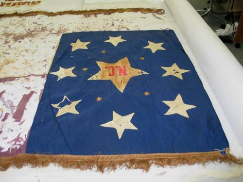 Goldsboro Rifles Flag, silk with embroidery and fringe, poor condition. North Carolina Museum of History collections, Accession number 1922.21.1.