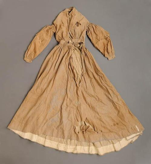 Cotton calico dress made by slave Combo on Robeson Plantation. North Carolina Museum of History, accession number 1993.535.1