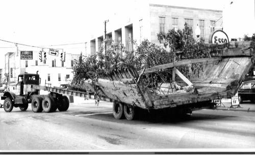 A portion of the CSS Neuse on the move in 1964.  A tree that was in the way of the move was cut and laid down in the boat. Photo courtesy NC State Historic Sites.