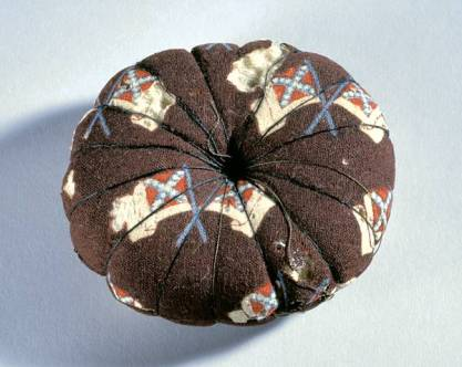Pincushion made by Fanny Waddell of Nash County NC from blockade fabric featuring Confederate flags. NC Museum of History, accession number 1917.18.1