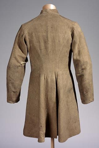 Homemade coat features homespun lining.  Collections of the North Carolina Museum of History, accession number 1965.78.1