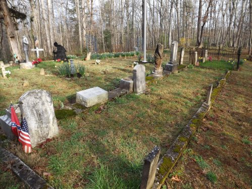 Henry family burial plots, Harrie Deaver near the end, before the fenced plots.