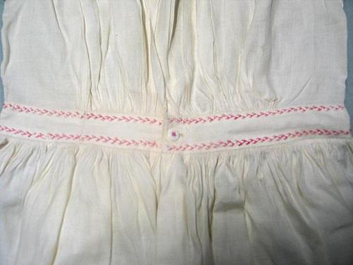 Back Waistband detail. Child's Dress with embroidered detail. North Carolina Museum of History, Accession Number H.1964.2.2